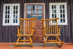 Teak wood chair with window and door Royalty Free Stock Photos