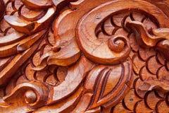 Teak wood craving Stock Images