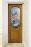 Teak wood door  with mirror glass - Background. Royalty Free Stock Photos