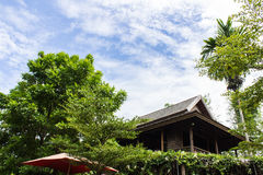 Teak wood home lanna Thailand style with sky Royalty Free Stock Photo