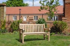 Teak wooden garden bench stock photos