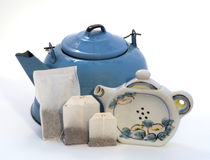 Teakettle, tea bags, & teapot shape teabag holder Stock Photo