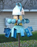 Teakettle Whirligig. Windblown spinning whirligig made from assorted cups and kitchen items, topped with a tea kettle Royalty Free Stock Photography