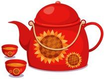 Teakrukan med kuper av tea Royaltyfri Foto