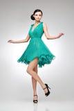 teal платья брюнет стоковое изображение