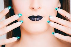 Teal, Black, and White Nail Art royalty free stock image