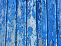 Aqua or teal blue Vintage or shabby style wooden wall. Paint is peeling off the wood planks royalty free stock photography
