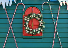 Teal blue wall with candy canes and holiday wreath Stock Image