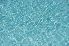 Teal Blue Water in a Swimming Pool Stock Photography