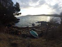 Teal boat landscape Royalty Free Stock Images