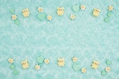 Teal candy hearts, teddy bears and rose buds on pale teal plush fabric background. With muted mix of shades to provide copy-space for your message royalty free stock photography