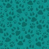 Teal cat paw prints seamless pattern background. Teal cat paw prints seamless and repeats pattern background with texture stock photo