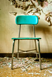 Teal Chair in Abandoned Building royalty free stock image