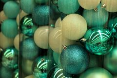Teal Christmas ornaments. Christmas ornaments in teal and pastel blue colors in a christmas retail shop Stock Photo