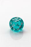 Teal colored isolated dice Royalty Free Stock Photos