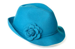 Teal felt hat. A teal blue felt hat with a flower on it Stock Image