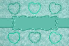 Teal frame hearts on pale teal rose plush fabric with ribbon background. Teal frame hearts on pale teal rose plush fabric background with ribbon to provide copy stock photography