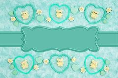 Teal frame hearts, teddy bears and rose buds on pale teal rose plush fabric with ribbon background. Teal frame hearts, teddy bears and rose buds on pale teal royalty free stock images