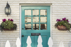 Teal front door of a classic home stock images