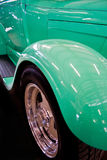 Teal Glossy Wheel Well of Vintage Car. Detail of the wheel of a teal classic car Royalty Free Stock Images