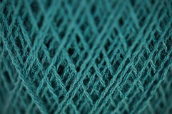 Teal Merino Fine Yarn Macro. Macro close-up detail from a fine merino yarn spool with a nice vivid teal color Royalty Free Stock Photography