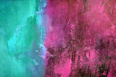 Teal and Pink. Textured plaster wall painted in teal and pink stock photography