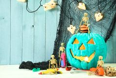 Teal pumkin and Halloween toy treats. Teal pumpkin Jack O` Lantern indicates that this place provides allergy free non food treats for Halloween trick or Stock Photos