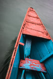 Teal and red canoe Stock Images