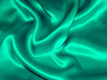Teal Satin Background. Teal green satin fabric stock photos