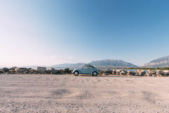 Teal Volkswagen Beatle Parked Near Beach during Daytime Stock Photography