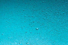 Teal water drops abstract background Stock Image
