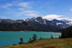 Teal waters of the Gibson Reservoir fed by the Sun river, Montana royalty free stock photos