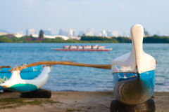 Teal and white fiberglass outrigger canoe. With ama for balance stock image