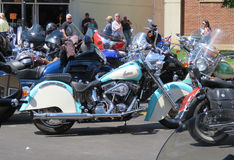 Teal and white Indian Motorcycle at Sturgis, SD, motorcycle rally. Riders, pedestrians and motorcycles on the street during the Sturgis, South Dakota 77th Annual Stock Photos