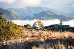 Teal and Yellow Dome Tent on Peach Leveled With Clouds Near Mountain Under Daytime Royalty Free Stock Photos