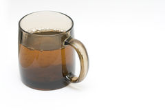 Tealeafs. A transparent black cup with tea and tealeafs Stock Photo