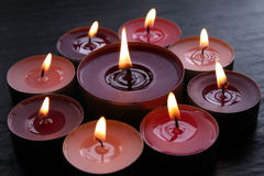 Tealight Candles. Candles arranged in a circle royalty free stock image