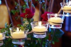 Tealight candles. Tea-light candles at a wedding reception Stock Photos