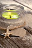 Tealight glass on a sandy ground Royalty Free Stock Photography