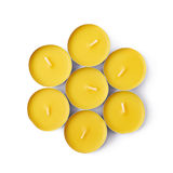 Tealight paraffin wax candle isolated. Pile of tealight paraffin wax yellow candles isolated over the white background Stock Image