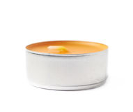 Tealight paraffin wax candle isolated Royalty Free Stock Photos