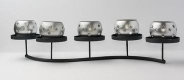 Tealight stearinljus med stjärnor på metallställningen Front View Royaltyfri Bild