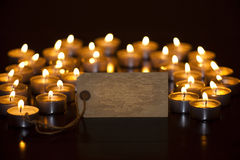 Tealights. Several tea lights with sign royalty free stock images
