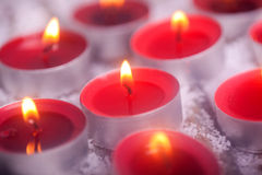 Tealights with golden flame Royalty Free Stock Images