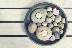 Tealights with pebbles and seashells Royalty Free Stock Photos