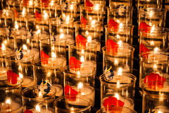 Tealights with poppies against the world war. Royalty Free Stock Photos