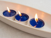 Tealights in a  pottery bowl Stock Images