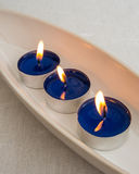 Tealights in a  pottery bowl Stock Photo