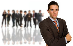 Team. Business man with some people in the back Stock Images