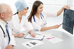 Team. Professor and young female doctors Stock Image